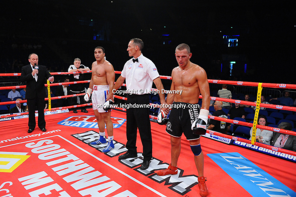 Louis Cuddy (white shorts) defeat Stanislavs Makarenko at the Echo Arena, Liverpool on 6th July 2013. Credit: © Leigh Dawney Photography. Self Billing where applicable. Tel: 07812 790920