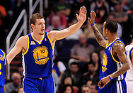 Feb. 22, 2012; Phoenix, AZ, USA;  Golden State Warriors forward David Lee (10) and teammate guard Monta Ellis (8) reacts on the court against the Phoenix Suns at the US Airways Center.  The Warriors defeated the Suns 106 - 104. Mandatory Credit: Jennifer Stewart-US PRESSWIRE.