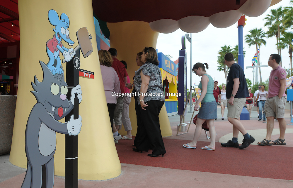 Guests enter the newly-opened The Simpson's Ride at Universal Orlando in Orlando, Fla., Tuesday, April 29, 2008. (Photo by Phelan M. Ebenhack)