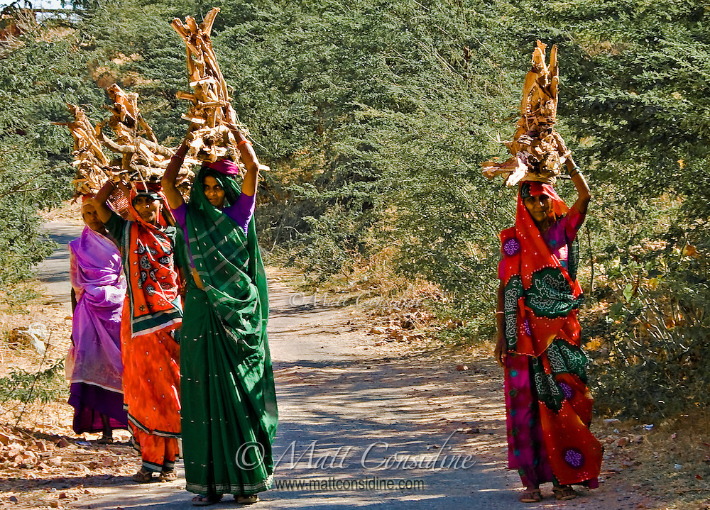 With the wood twisted into a stable pyramid, these colorfully dressed women often walk miles each day.<br /> (Photo by Matt Considine - Images of Asia Collection)