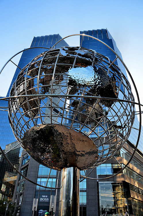 Steel Globe at Columbus Circle in New York City, New York<br /> This globe by artist Kim Brandell shows the earth&rsquo;s continents suspended on steel rings that represent latitude and longitude lines.  It stands in a plaza at the base of the Trump International Hotel &amp; Tower near Central Park.  Its neighbors in Columbus circle are the 750 foot, twin towers of the Time Warner Center in the background.  The company sold the building in 2014 and announced their plans to move out by 2019.
