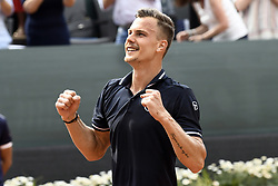 GENEVA, May 27, 2018  Marton Fucsovics of Hungary celebrates after winning the men's final against Peter Gojowczyk of Germany at the 2018 Geneva Open ATP 250 Tennis tournament in Geneva, Switzerland, on May 26. Marton Fucsovics won 2-0. (Credit Image: © Alain Grosclaude/Xinhua via ZUMA Wire)