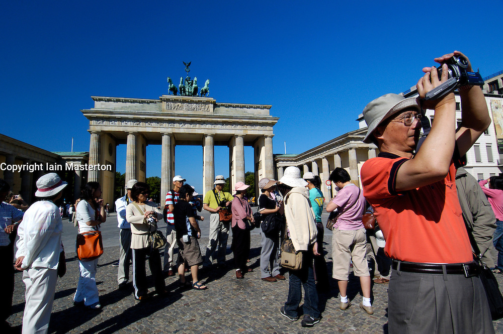 Chinese tourists visiting the Brandenburg Gate in Berlin Germany