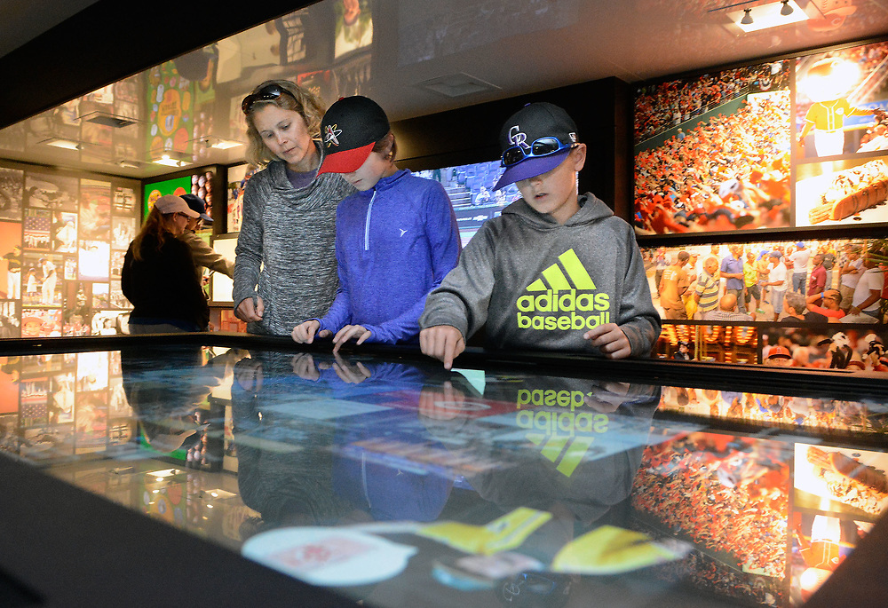 jt051917f/ sports/jim thompson/  Jen Ellefson and her kids Mattie Lupo-10 and Das Lupo-8 check out the interactive tabletop in one of the trailers of the Baseball Hall of Fame Tour at Isotopes Park. Friday May. 19, 2017. (Jim Thompson/Albuquerque Journal)