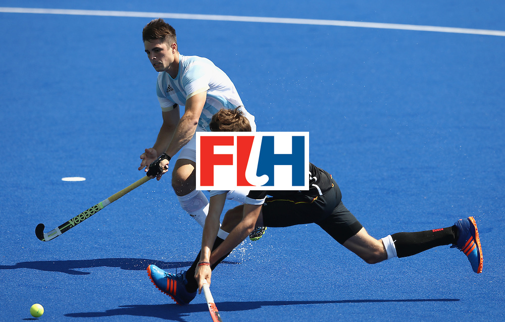 RIO DE JANEIRO, BRAZIL - AUGUST 16:  Florian Fuchs of Germany is tackled during the Men's semi final hockey match between rgentina and Germany on Day 11 of the Rio 2016 Olympic Games held at the Olympic Hockey Centre on August 16, 2016 in Rio de Janeiro, Brazil.  (Photo by David Rogers/Getty Images)