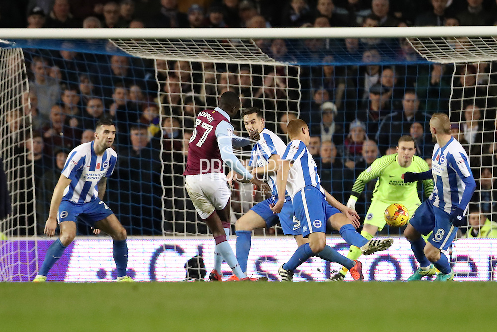 Aston Villa midfielder Albert Adomah (37) shoots at goal during the EFL Sky Bet Championship match between Brighton and Hove Albion and Aston Villa at the American Express Community Stadium, Brighton and Hove, England on 18 November 2016.
