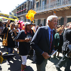 Former New Orleans Saints head coach Jim Mora walks among fans during a second line following the funeral service for NFL New Orleans Saints owner and NBA New Orleans Pelicans owner Tom Benson in New Orleans, Friday, March 23, 2018. Benson died last Thursday at the age of 90. (AP Photo/Derick Hingle)