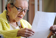 Patient Shirley Derstine, 82, reads aloud during Spirit Alive, a religious service for people with dementia that incorporates Montessori principles Wednesday, June 28, 2017 at Meadow Glen Personal Care in Richlandtown, Pennsylvania. (WILLIAM THOMAS CAIN / For The Philadelphia Inquirer)