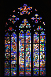 Prague, Czech Republic:  One of the many stained glass windows that decorate the individual chapels of St. Vitus Cathedral (Katedrala Sv. Vita) within the Castle Square complex.