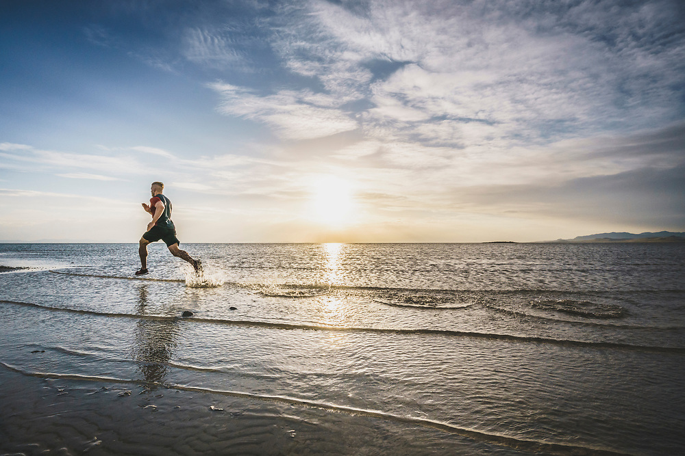 Robert Hunter performs a set of wind sprints in the shallows of the Great Salt Lake, Utah.