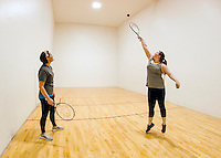 Hillary Stanley and Mikenzie Watson play a game of racquetball in the court at the Laconia Community Center on Wednesday afternoon.  (Karen Bobotas/for the Laconia Daily Sun)