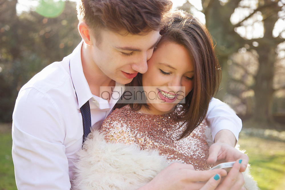 Young Couple Using Cell Phone