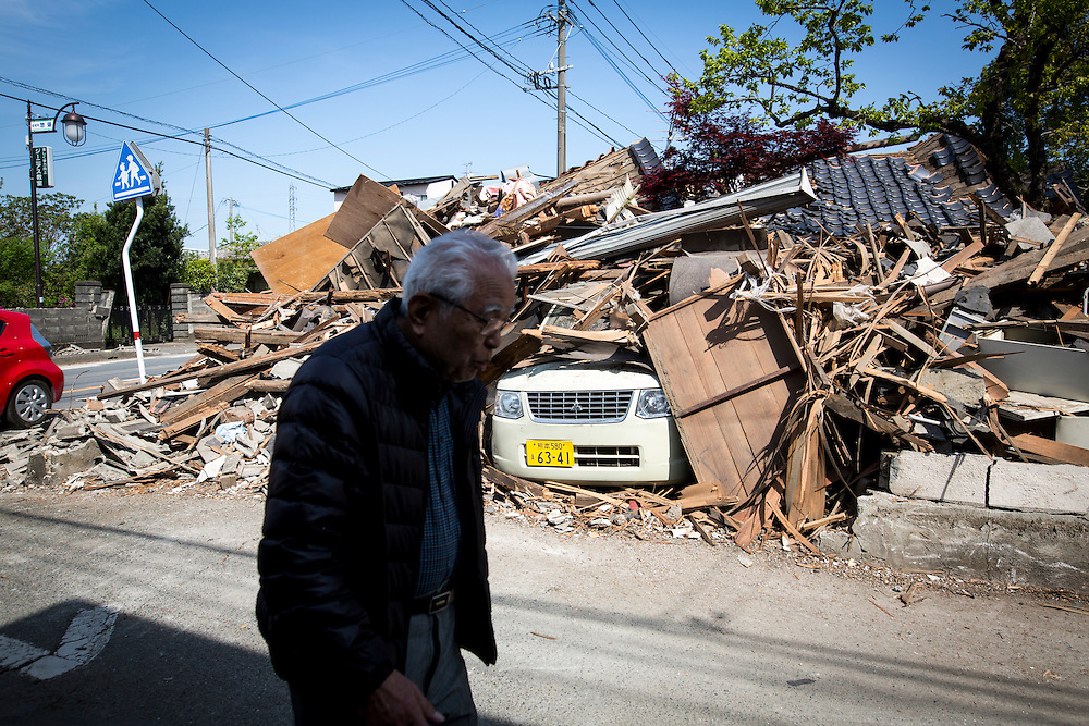 KUMAMOTO, JAPAN - APRIL 20 : A man is seen through the wreckage of houses on April 20, 2016 in Mashiki town, Kumamoto, Japan. At least 41 people were killed and over 180,000 people were evacuated in the series of earthquakes hitting southwestern Japan since 14 April 2016.<br /> Photo: Richard Atrero de Guzman