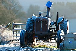 © Licensed to London News Pictures. 05/01/2017. Builth Wells, Powys, Wales, UK. An old tractor is seen frosted up in the cold early morning landscape in Powys, Mid Wales, UK after temperatures dropped to minus 4 degrees centigrade last night. Photo credit: Graham M. Lawrence/LNP