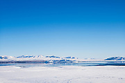Snow-covered mountains and lake in stunning glacial landscape in South Iceland