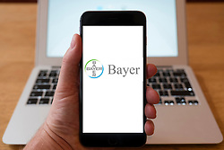 Using iPhone smartphone to display logo of Bayer pharmaceutical company