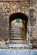 Arch passage at Orvieto, Italy.  Stairwys goes trhough the arch.