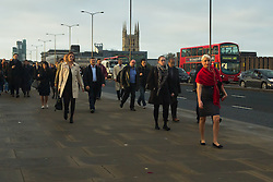 © Licensed to London News Pictures. 17/10/2014. London, UK. Commuters cross London Bridge in mild sunny weather early this morning. Photo credit : Vickie Flores/LNP