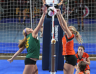 LeMars Gehlen Catholic's Amber Timmins (15) battles with Tripoli's Erica Ollendieck (5) at the net during their 1A semifinal match in the state volleyball tournament at the U.S. Cellular Center at 370 1st Ave E on Friday evening, November 12, 2010. (Stephen Mally/Freelance)