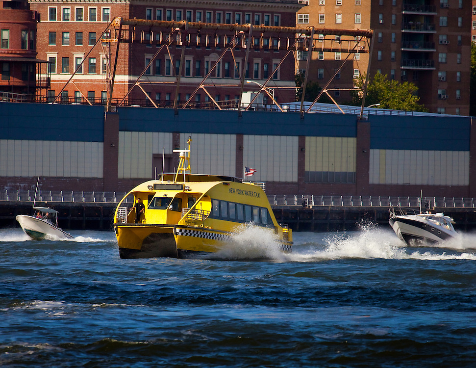 Racing boats on a choppy day in the East River.