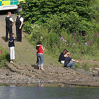 Tay River Accident...13.7.2005.<br /> Teenagers believed to be friends of the victim look down the river to where their friend in being given CPR. <br /> (Please see Gordon Currie story 01738 446766).<br /> <br /> NO BYLINE TO BE USED WITH IMAGE.<br /> Picture by John Lindsay<br /> COPYRIGHT: Perthshire Picture Agency.<br /> Tel. 01738 623350 / 07775 852112.