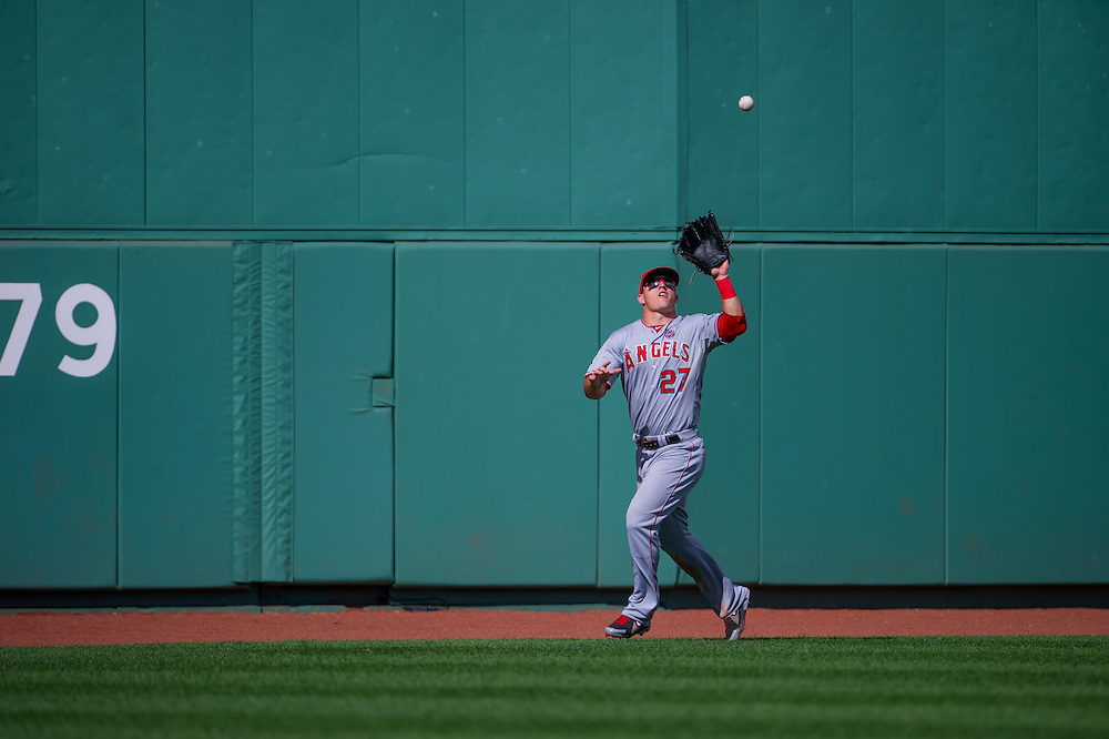 BOSTON, MA - JUNE 09: Mike Trout #27 of the Los Angeles Angels defends his position during the game against the Boston Red Sox at Fenway Park in Boston, Massachusetts on June 9, 2013. (Photo by Rob Tringali) *** Local Caption *** Mike Trout