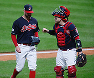 October 11, 2017 - Cleveland, OH, USA - Cleveland Indians starting pitcher Corey Kluber, left, gets a fist-bump from catcher Roberto Perez in the first inning against the New York Yankees during Game 5 of the American League Division Series, Wenesday, Oct. 11, 2017, at Progressive Field in Cleveland. (Credit Image: © Leah Klafczynski/TNS via ZUMA Wire)