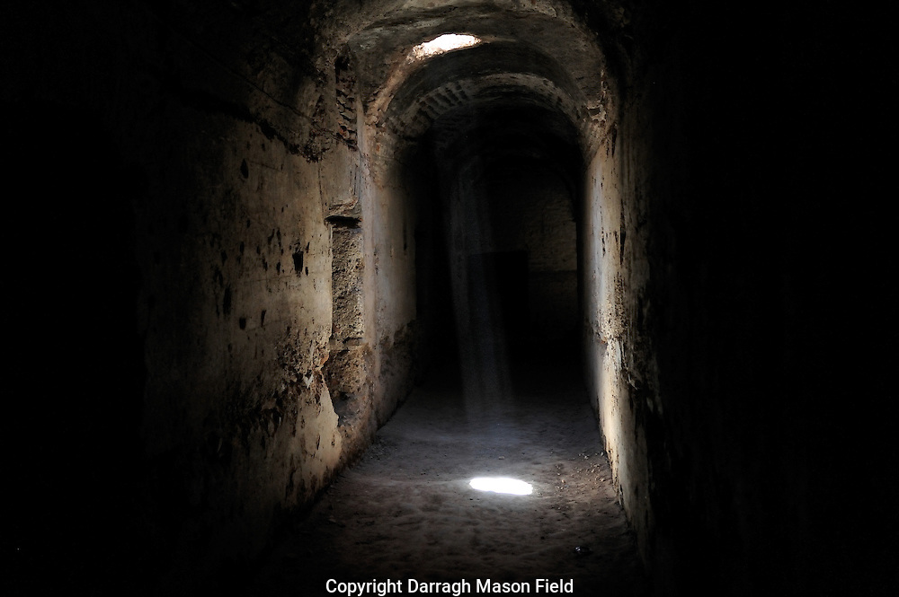 A shaft of light penetrates the dungeons of El Badi Palace which is located in Marrakech, Morocco, and it consists nowadays of the remnants of a magnificent palace built by the Saadian king Ahmad al-Mansur in 1578.