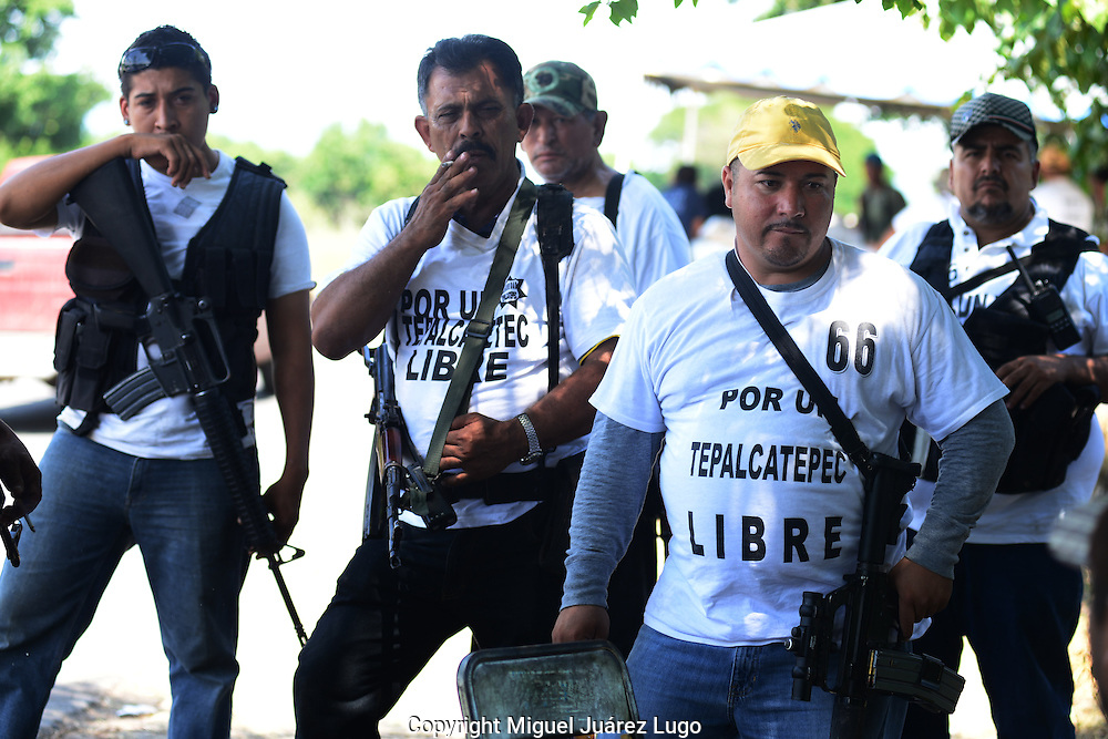 Self defense forces gather outside the town of Buenavista Tomatlan.  Locals from at least a dozen towns are coming together to fight the Knights Templar drug gang that has terrorized the region for the past two years.