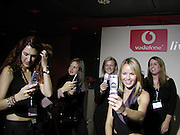 Amanda Holden. Vodafone launch. Broadwick St. 24 October 2002. © Copyright Photograph by Dafydd Jones 66 Stockwell Park Rd. London SW9 0DA Tel 020 7733 0108 www.dafjones.com
