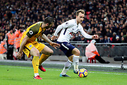 Christian Eriksen of Tottenham Hotspur (23) dribbling during the Premier League match between Tottenham Hotspur and Brighton and Hove Albion at Wembley Stadium, London, England on 13 December 2017. Photo by Matthew Redman.
