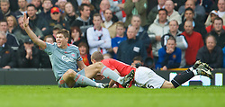 MANCHESTER, ENGLAND - Saturday, March 14, 2009: Liverpool's captain Steven Gerrard MBE is cynically brought down by the last man Manchester United's Nemanja Vidic, who is subsequently sent off, during the Premiership match at Old Trafford. (Photo by David Rawcliffe/Propaganda)