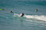 Wave Surfing in the Mediterranean Sea. Netanya, Israel