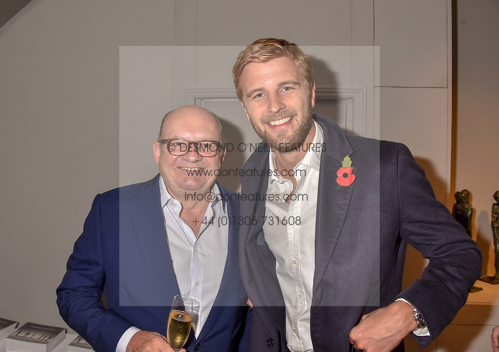 Left to right, Michael Spencer and Harry Wentworth-Stanley at a private view of recent work by Georgiana Anstruther held at the Sladmore Gallery, 32 Bruton Place, London England. 08 November 2018. <br /> <br /> ***For fees please contact us prior to publication***
