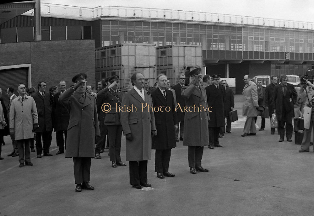 Canadian Prime Minister, Pierre Trudeau arrives in Dublin    (J17).14.03.1975.03.14.1975.3rd April 1975..Pierre Trudeau arrived today for a brief visit to Ireland. He was greeted by the Taoiseach Mr. Liam Cosgrave on his arrival at Dublin Airport..Photograph of Canadian Prime Minister Pierre Trudeau alongside An Taoiseach Liam Cosgrave as they listen to the playing of national anthems.