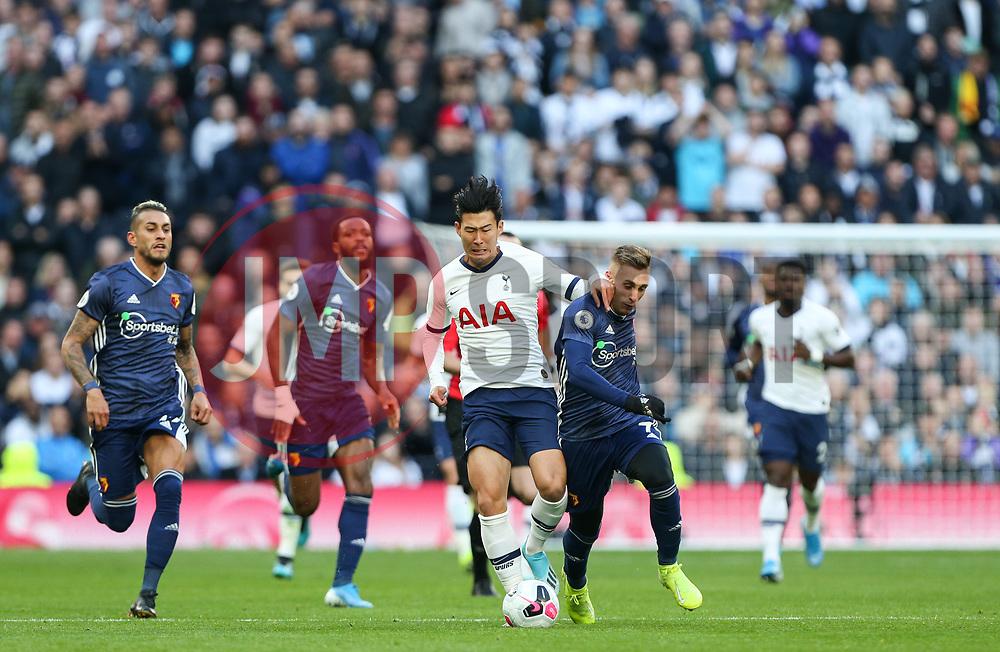 Son Heung-Min of Tottenham Hotspur and Gerard Deulofeu of Watford tussle for the ball - Mandatory by-line: Arron Gent/JMP - 19/10/2019 - FOOTBALL - Tottenham Hotspur Stadium - London, England - Tottenham Hotspur v Watford - Premier League