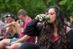 "© Licensed to London News Pictures. 25/05/2019. Bristol, UK. MIKA CURTIS with a can of cider at a ""drink-in"" protest, organised by Bristol Momentum Youth, held in Bristol's Castle Park against fines under a Public Space Protection Orders (PSPOs) now being implemented by Bristol City Council which are used to ban alcohol drinking in certain areas. Though most of the alcohol in public bans have been in place since late 2017, they weren't actively enforced until this year when contractor 3GS took over the council contract for litter and other rules enforcement in outside spaces from previous contractor Kingdom. The PSPO rule states that: ""No person in the restricted area shall be in possession of any opened or unsealed bottle or container of alcohol"". The fines can be up to £100 and protestors say it will disproportionately affect the least well off in the community who are also likely be targeted more with the fines in the first place, and is another step in eroding the use of public space. Photo credit: Simon Chapman/LNP."