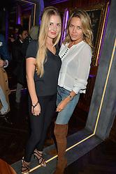 Left to right, ELEONORA SEBROVA and model TETYANA VERYOVKINA at the launch of MNKY HSE Restaurant, 10 Dover Street, London on 19th October 2016.