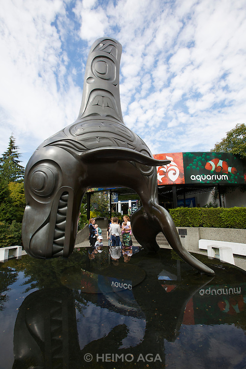 "Stanley Park. Vancouver Aquarium. Famous First Nations artist Bill Reid's Orca sculpture ""Chief of the Undersea World"" at the entrance."