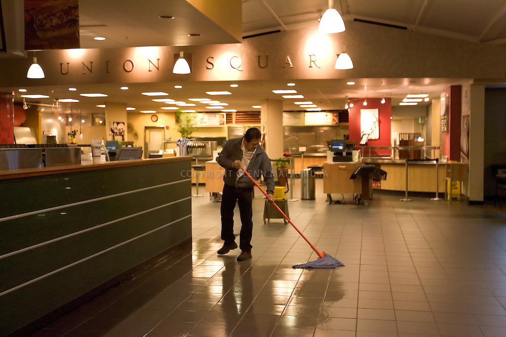 Stanford after dark. Janitor cleans Stanford Tressider Union Square.
