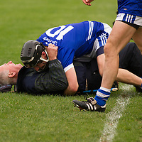 Cratloe's Manager Joe McGrath and Shane Gleeson celebrate adter the final whistle sounds