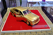 SHENYANG, CHINA - DECEMBER 11: (CHINA OUT) <br /> <br /> Rolls-Royce Golden Car Model Valued AT 2,580,000 Yuan<br /> <br /> A Rolls-Royce golden car model which values 2,580,000 yuan (about 399,642 dollar) is seen at a golden car exhibition in a shopping mall on December 11, 2015 in Shenyang, Liaoning Province of China. The golden car model is made of high purity gold of 99.99%, car lights and glasses of red and blue rubies<br /> ©Exclusivepix Media