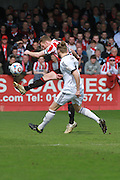 Kyle Storer and Kingsley James during the Vanarama National League match between Cheltenham Town and FC Halifax Town at Whaddon Road, Cheltenham, England on 16 April 2016. Photo by Antony Thompson.