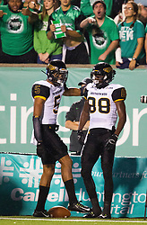 Oct 9, 2015; Huntington, WV, USA; Southern Miss Golden Eagles wide receiver Michael Thomas (88) and wide receiver DJ Thompson (5) celebrate after scoring a touchdown in the first quarter against the Marshall Thundering Herd  at Joan C. Edwards Stadium. Mandatory Credit: Ben Queen-USA TODAY Sports