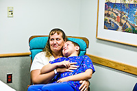 Corey Haas, 8, is comforted by his mother, Nancy, before he enters surgery at the UPenn Medical Center in Philadelphia, PA on Thursday, September 25, 2008. Corey is sight-impaired and will undergo surgery injecting genetic material into his left eye in hopes of improving his vision.