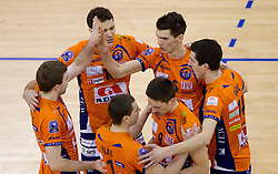 Players of ACH celebrate during volleyball match between ACH Volley (SLO) and Knack Roeselare (BEL) at Quarterfinals of CEV Challenge Cup 2011/2012, on February 8, 2012 in Arena Tivoli, Ljubljana, Slovenia. ACH Volley defeated Knack Roeselare  3-0. (Photo By Vid Ponikvar / Sportida.com)
