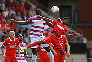 Barnet striker, John Akinde and Bradley Pritchard compete for a high ball during the Sky Bet League 2 match between Leyton Orient and Barnet at the Matchroom Stadium, London, England on 8 August 2015. Photo by Bennett Dean.