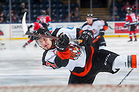 KELOWNA, CANADA - NOVEMBER 25: Hayden Ostir #7 of the Medicine Hat Tigers takes a shot during warm up against the Kelowna Rockets on November 25, 2017 at Prospera Place in Kelowna, British Columbia, Canada.  (Photo by Marissa Baecker/Shoot the Breeze)  *** Local Caption ***