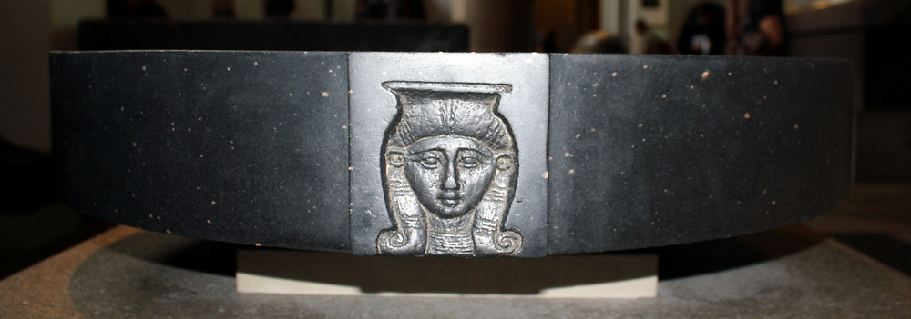 Black Basalt libation bowl. Twenty Sixth Dynasty, about 625 BC. The rim of the bowl is decorated with two heads of the goddess Hathor.