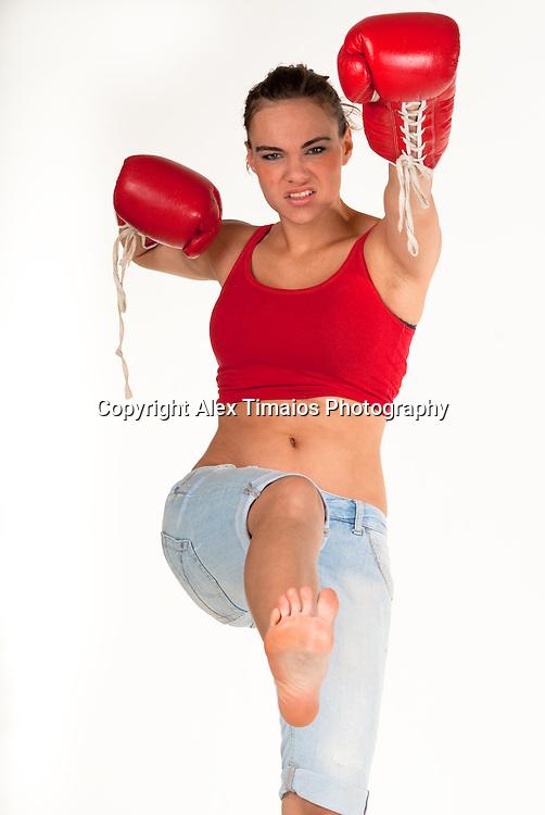 female kickboxer . Isolated in white.